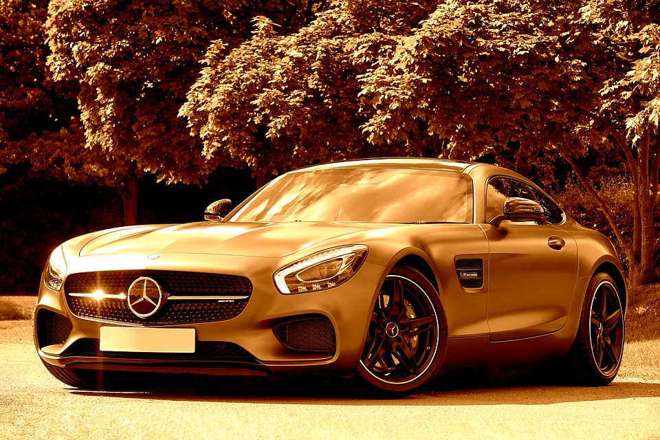 Sepia image of a Mercedes Benz. Image for the article Are you high class? NZ Pleasures.