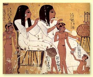 An ancient Egyptian fresco showing two women attending to a childs hair